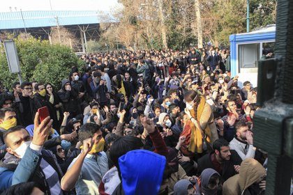 In this image, taken on December 30, 2017 by an outsider to The Associated Press and obtained by the AP outside Iran, university students participate in a protest inside Tehran University while riot police prevent them from joining other protesters, in Tehran, Iran.  (AP Photo, file)
