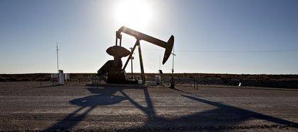 A pumpjack operates on an oil well in the Permian Basin near Orla, Texas.