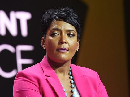 "(FILES) In this file photo taken on July 06, 2018 Mayor of Atlanta Keisha Lance Bottoms speaks onstage during the 2018 Essence Festival presented by Coca-Cola at Ernest N. Morial Convention Center in New Orleans, Louisiana. - Mayor of Atlanta Keisha Lance Bottoms announced July 6 in a Teweet she tested positive for coronavirus: ""COVID-19 has literally hit home. I have had NO symptoms and have tested positive."" (Photo by Paras Griffin / GETTY IMAGES NORTH AMERICA / AFP)"
