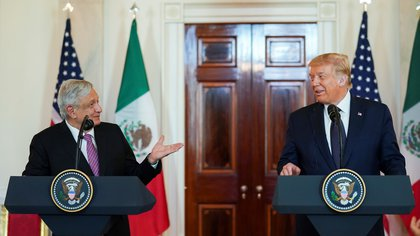 Mexico's President Andres Manuel Lopez Obrador and U.S. President Donald Trump make joint statements in the White House Cross Hall before holding a working dinner together at the White House in Washington, U.S., July 8, 2020. REUTERS/Kevin Lamarque