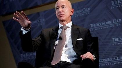 "FILE PHOTO: Jeff Bezos, president and CEO of Amazon and owner of The Washington Post, speaks at the Economic Club of Washington DC's ""Milestone Celebration Dinner"" in Washington"