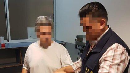 Minetti al ser extraditado