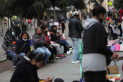 People sit in public spaces without keeping social distance, amidst the coronavirus disease (COVID-19) outbreak, in Bogota, Colombia October 23, 2020. Picture taken October 23, 2020. REUTERS/Luisa Gonzalez