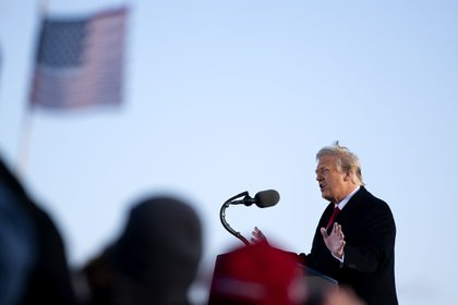 U.S. President Donald Trump speaks during a farewell ceremony at Joint Base Andrews, Maryland, U.S., on Wednesday, Jan. 20, 2021. Trump departs Washington with Americans more politically divided and more likely to be out of work than when he arrived, while awaiting trial for his second impeachment - an ignominious end to one of the most turbulent presidencies in American history. Photographer: Stefani Reynolds/Bloomberg