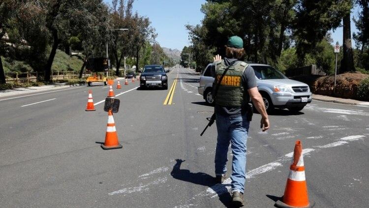 En el ataque hubo también tres heridos (Reuters/ John Gastaldo)
