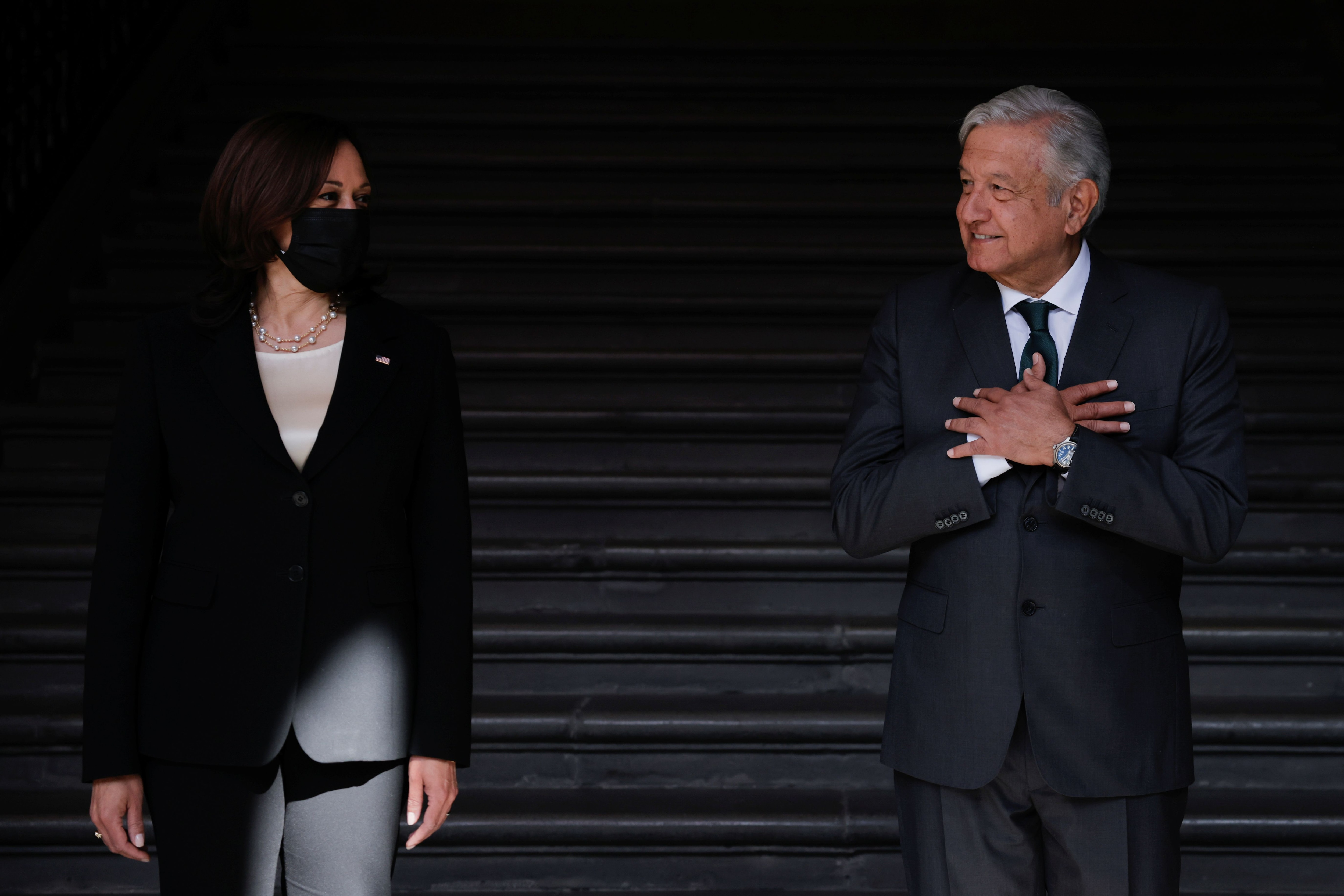 Mexico's President Andres Manuel Lopez Obrador gestures next to U.S. Vice President Kamala Harris as they attend the signing ceremony of a Memorandum of Understanding between the United States and Mexico to establish a strategic partnership to cooperate on development programs in the Northern Triangle at the Palacio Nacional in Mexico City, Mexico June 8, 2021.  REUTERS/Carlos Barria