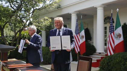 Donald Trump, right, and Andres Manuel Lopez Obrador, hold up joint declarations after being signed during a ceremony in the Rose Garden of the White House in Washington, D.C., U.S., on July 8.