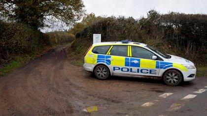El auto policial en el lugar donde buscaron el cuerpo dd Kate en 2011 (Press Association vía AP Images)