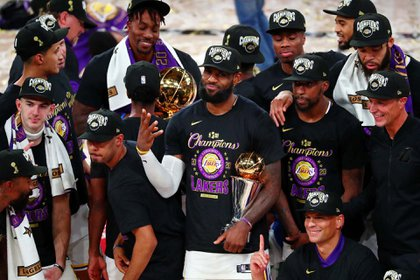 Oct 11, 2020; Lake Buena Vista, Florida, USA; Los Angeles Lakers forward LeBron James (23) holds up four fingers after winning his fourth NBA championship after game six of the 2020 NBA Finals at AdventHealth Arena. The Los Angeles Lakers won 106-93 to win the series. Mandatory Credit: Kim Klement-USA TODAY Sports