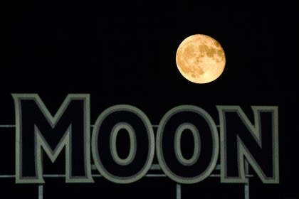 Sep 3, 2020; Kansas City, Missouri, USA; The moon is seen over a sign in right field during the seventh inning between the Chicago White Sox and the Kansas City Royals at Kauffman Stadium. Mandatory Credit: Jay Biggerstaff-USA TODAY Sports
