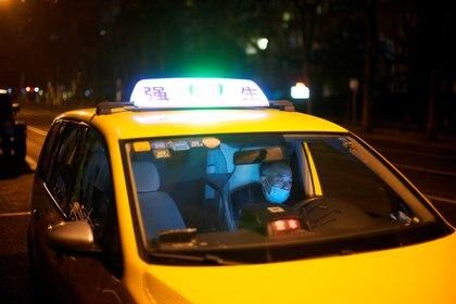 Los conductores de taxi chinos claman que la medida ataca sus libertades individuales