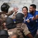 Soccer Football - Brasileiro Championship - Cruzeiro v Palmeiras - Mineirao Stadium, Belo Horizonte, Brazil - December 8, 2019 Cruzeiro fans clash with Riot police REUTERS/Cristiane Mattos