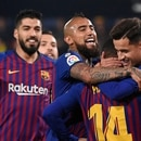 Barcelona's Brazilian midfielder Philippe Coutinho (R) celebrates with teammates after scoring during the Spanish league football match Villarreal CF against Barcelona at La Ceramica stadium in Vila-real on April 2, 2019. (Photo by JOSE JORDAN / AFP)