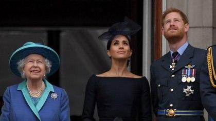 Isabel II, Harry y Meghan Markle