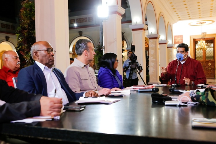 Venezuela's President Nicolas Maduro wears protective face mask as he speaks during a meeting at Miraflores Palace in Caracas, Venezuela March 13, 2020. Miraflores Palace/Handout via REUTERS ATTENTION EDITORS - THIS PICTURE WAS PROVIDED BY A THIRD PARTY. NO RESALES. NO ARCHIVES.