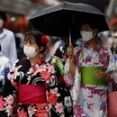 Women in yukata, or casual summer kimonos, wearing protective face masks, walk along Nakamise Street at Asakusa district, a popular sightseeing spot, amid the coronavirus disease (COVID-19) outbreak in Tokyo, Japan July 22, 2020. REUTERS/Issei Kato