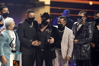 "Lenin Ramirez and Grupo Firme accept the award for regional Mexican song of the year for ""Yo Ya No Vuelvo Contigo"" at Premio Lo Nuestro at American Airlines Arena on Thursday, Feb. 18, 2021, in Miami. (AP Photo/Marta Lavandier)"