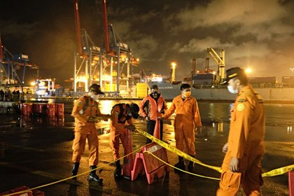 Rescue personnel set up an area to hold debris and remains of the Sriwijaya Air flight SJ 182 air crash victims, Jan. 9.