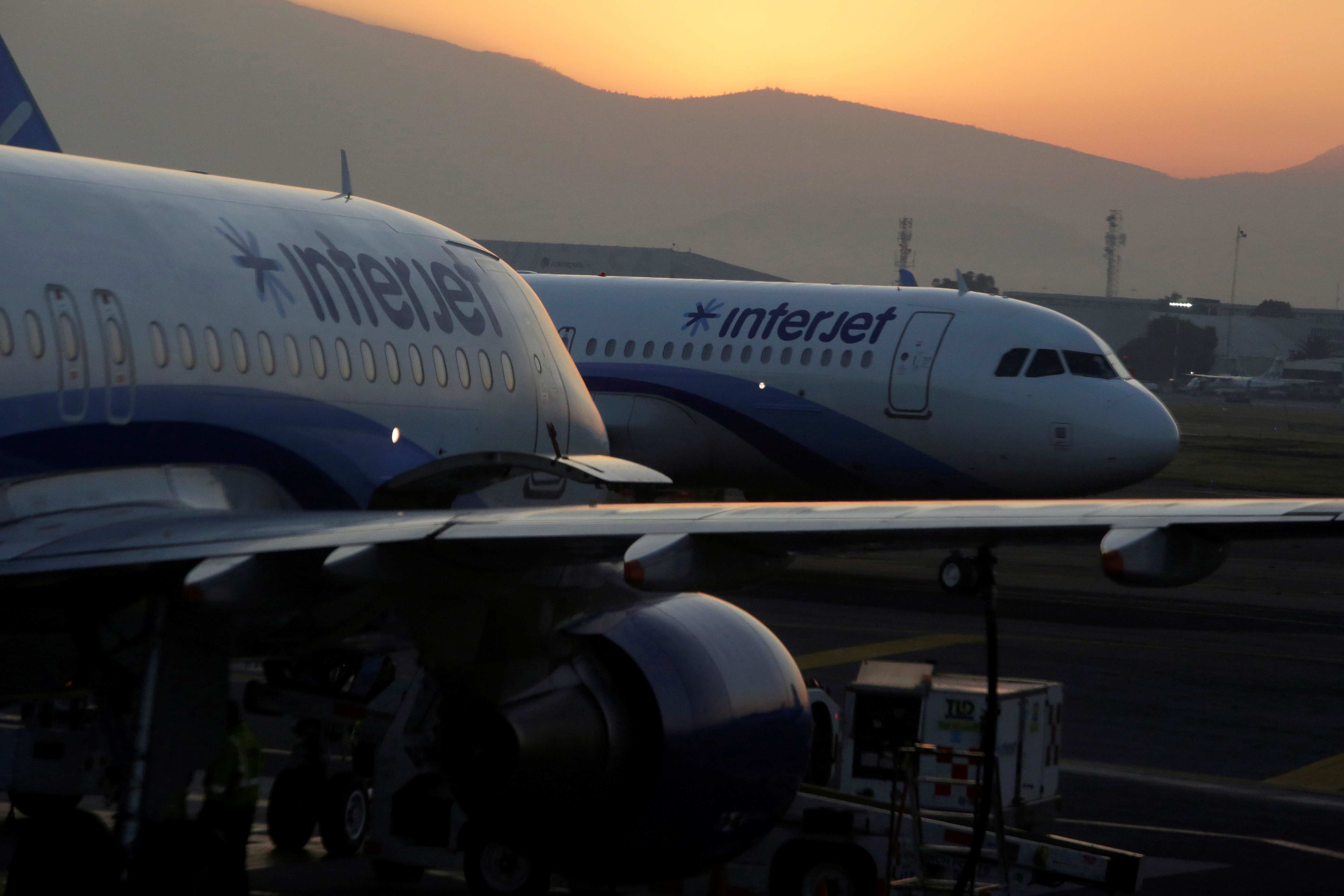 FILE PHOTO: Interjet Airbus A320 aircraft are seen on the tarmac at Benito Juarez international airport in Mexico City, Mexico, February 15, 2019. REUTERS/Daniel Becerril/File Photo