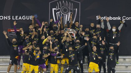 Dec 22, 2020; Orlando, Florida, USA; Tigres players celebrate by lifting the Scotiabank Champions League trophy after defeating Los Angeles FC at the 2020 SCCL final at Exploria Stadium. Mandatory Credit: Reinhold Matay-USA TODAY Sports