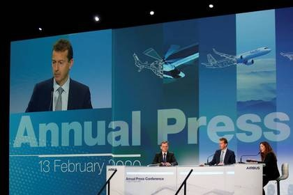 Airbus CEO Guillaume Faury, Julie Kitcher, Executive Vice-President Communications and Corporate Affairs of Airbus, and Chief Financial Officer of Airbus Dominik Asam attend Airbus's annual press conference on Full-Year 2019 results in Blagnac near Toulouse, France, February 13, 2020.  REUTERS/Regis Duvignau