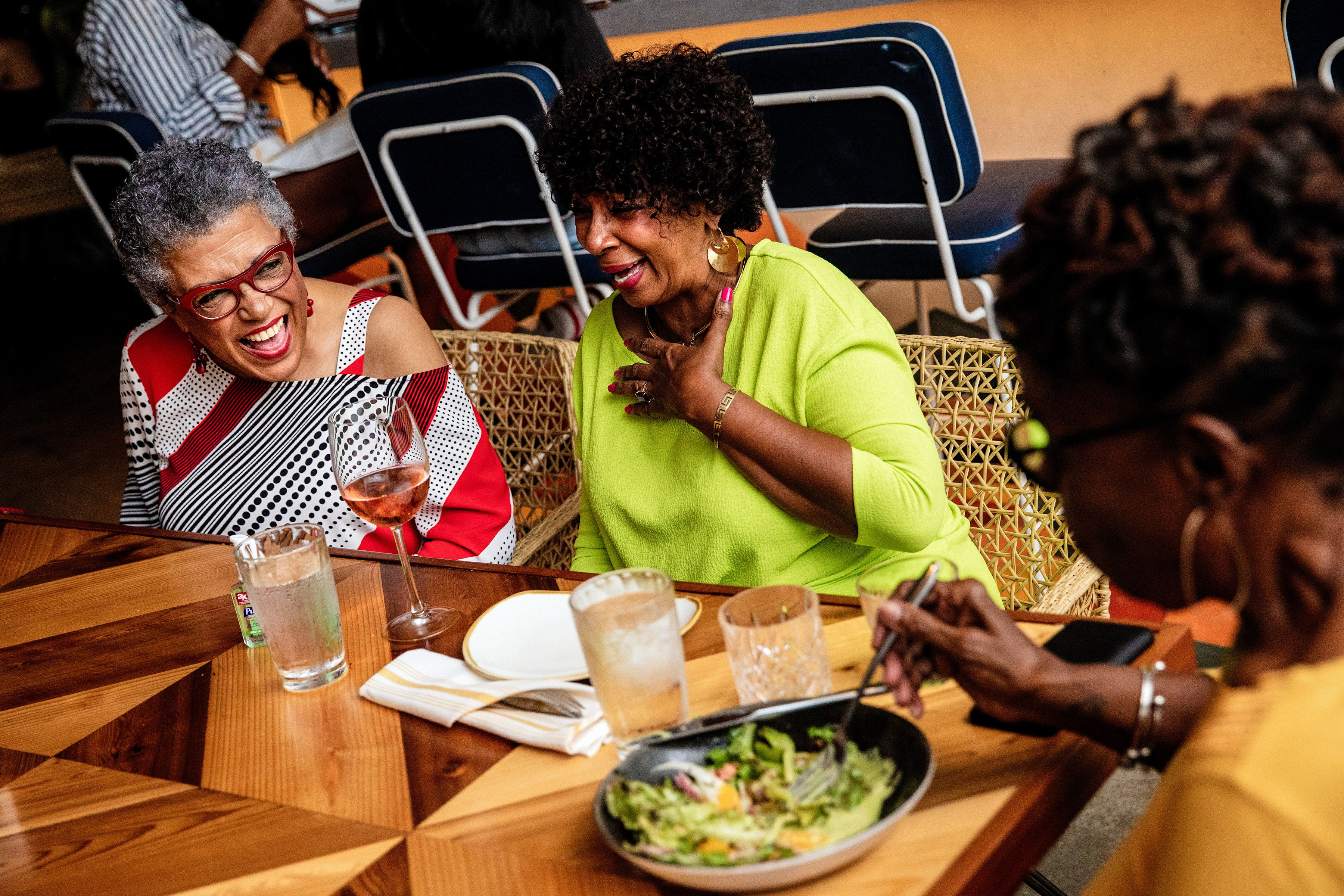 FILE -- Robbie Bell, 75, left, jokes with her friends Loretta McNeir, 68, center, and Anita McGruder, 72, at a restaurant in Miami on March 18, 2021. As some people start to shake off coronavirus precautions, those who are waiting their turn for a vaccine say the FOMO (fear of missing out) is real. (Scott McIntyre/The New York Times)