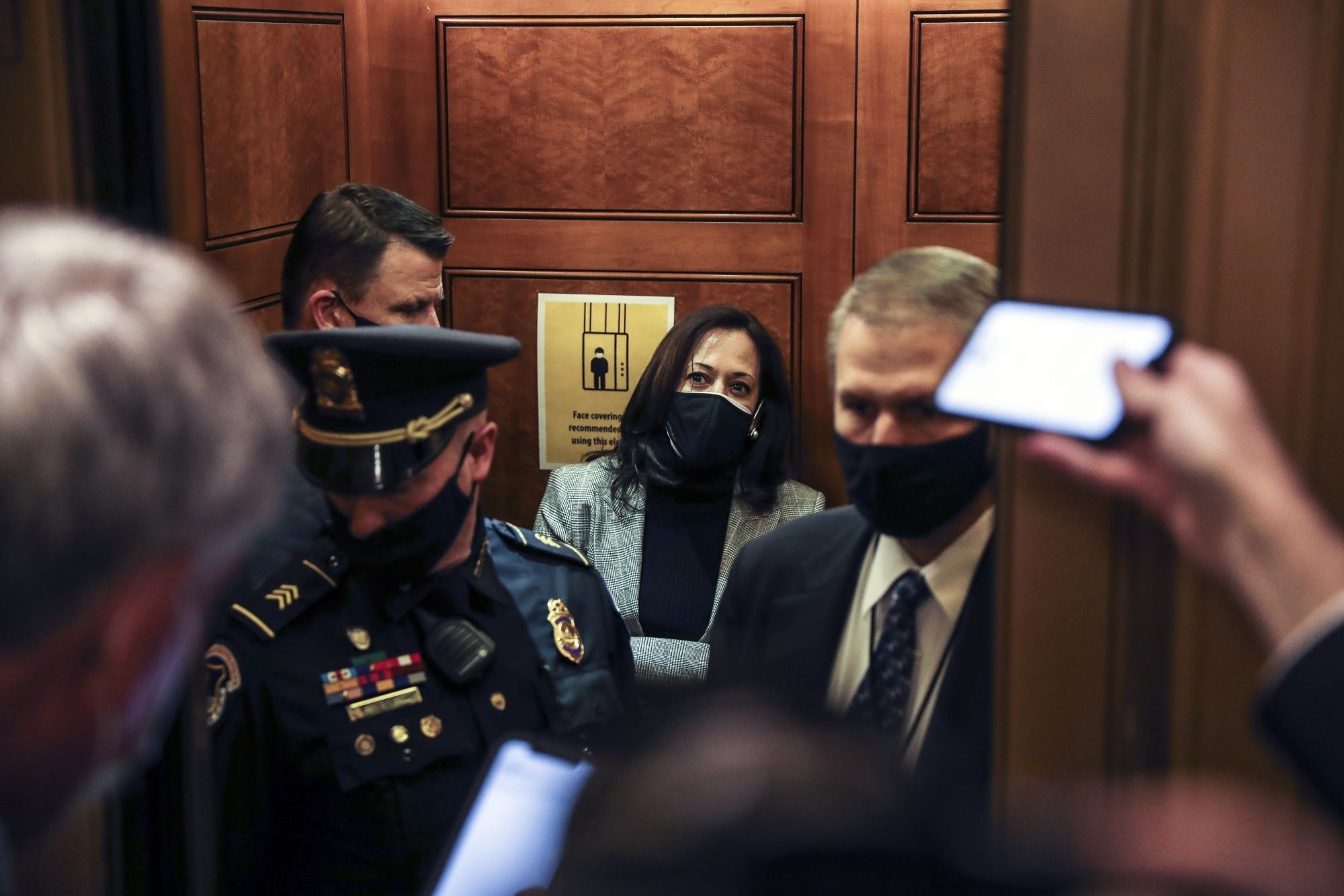 U.S. Vice President-elect Kamala Harris, wears a protective mask departs the Senate floor following a vote at the U.S. Capitol in Washington, D.C., U.S., on Monday, Dec. 21, 2020. The Senate passed a giant year-end spending bill combining $900 billion in Covid-19 relief aid with $1.4 trillion in regular government funding and a bevy of tax breaks for businesses.