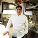 (FILES) In this file photo taken on February 15, 2018 Argentinian chief Mauro Colagreco poses in the kitchen of the