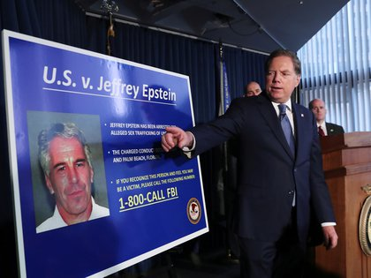 FILE PHOTO: Geoffrey Berman, United States Attorney for the Southern District of New York, points to a photograph of Jeffrey Epstein as he announces the financier's charges of sex trafficking of minors and conspiracy to commit sex trafficking of minors, in New York, U.S., July 8, 2019. REUTERS/Shannon Stapleton/File Photo