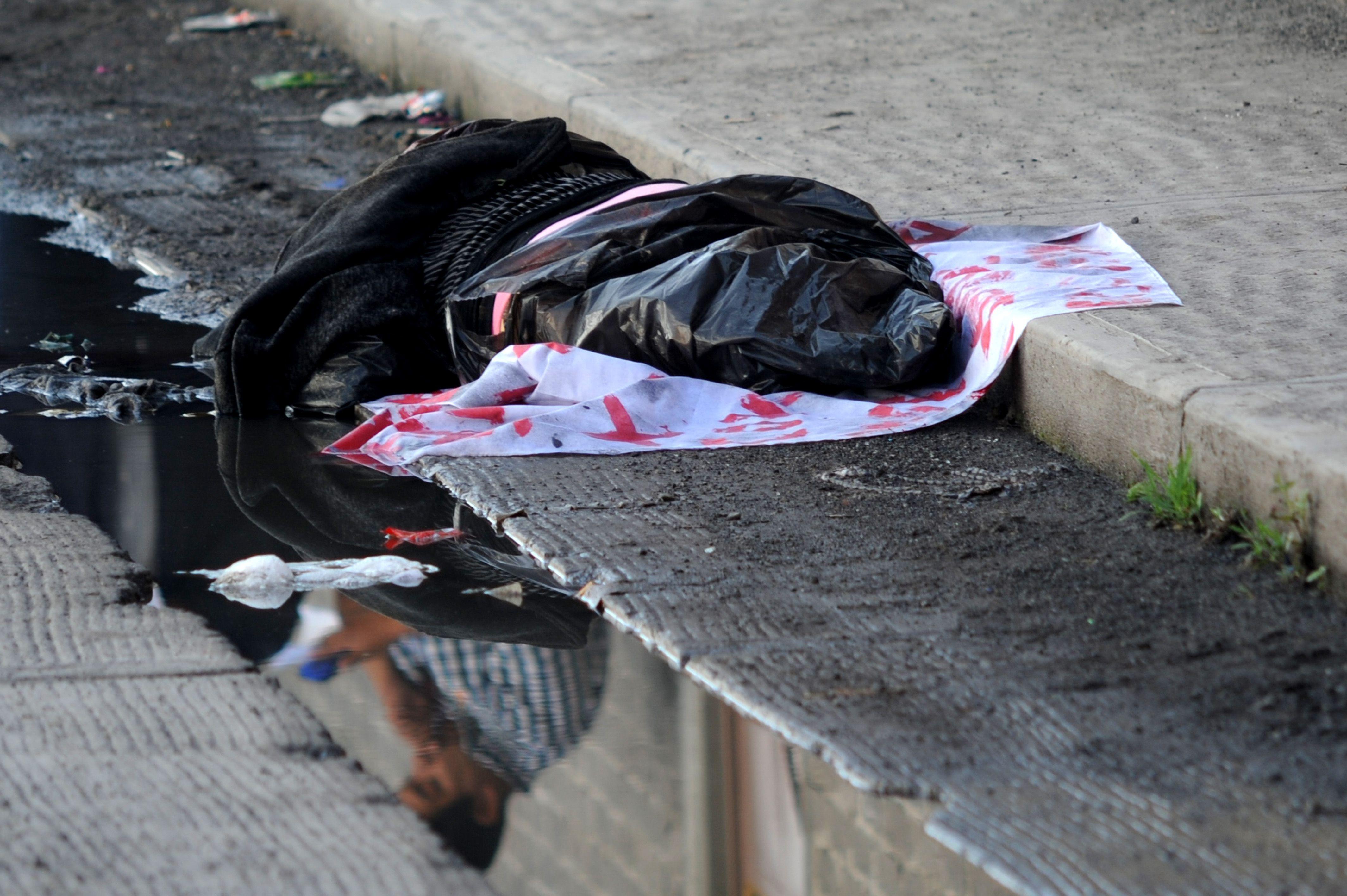 Fotografía ilustrativa. El cuerpo de una mujer con sapos amarrados al cuello fue encontrada en el fraccionamiento Valles del Sol, en Sinaloa (Foto: Cuartoscuro)