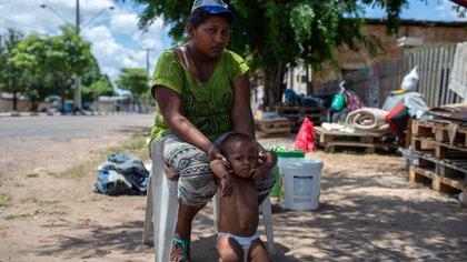 Venezolanos permanecen en el estado de Roraima, Brasil (AFP)