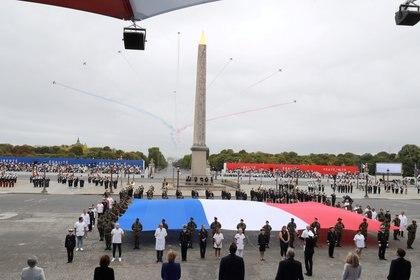 Una banda militar cantará el himno nacional, la Marsellesa, ante 2.000 invitados especiales. (Ludovic Marin/Pool via REUTERS)