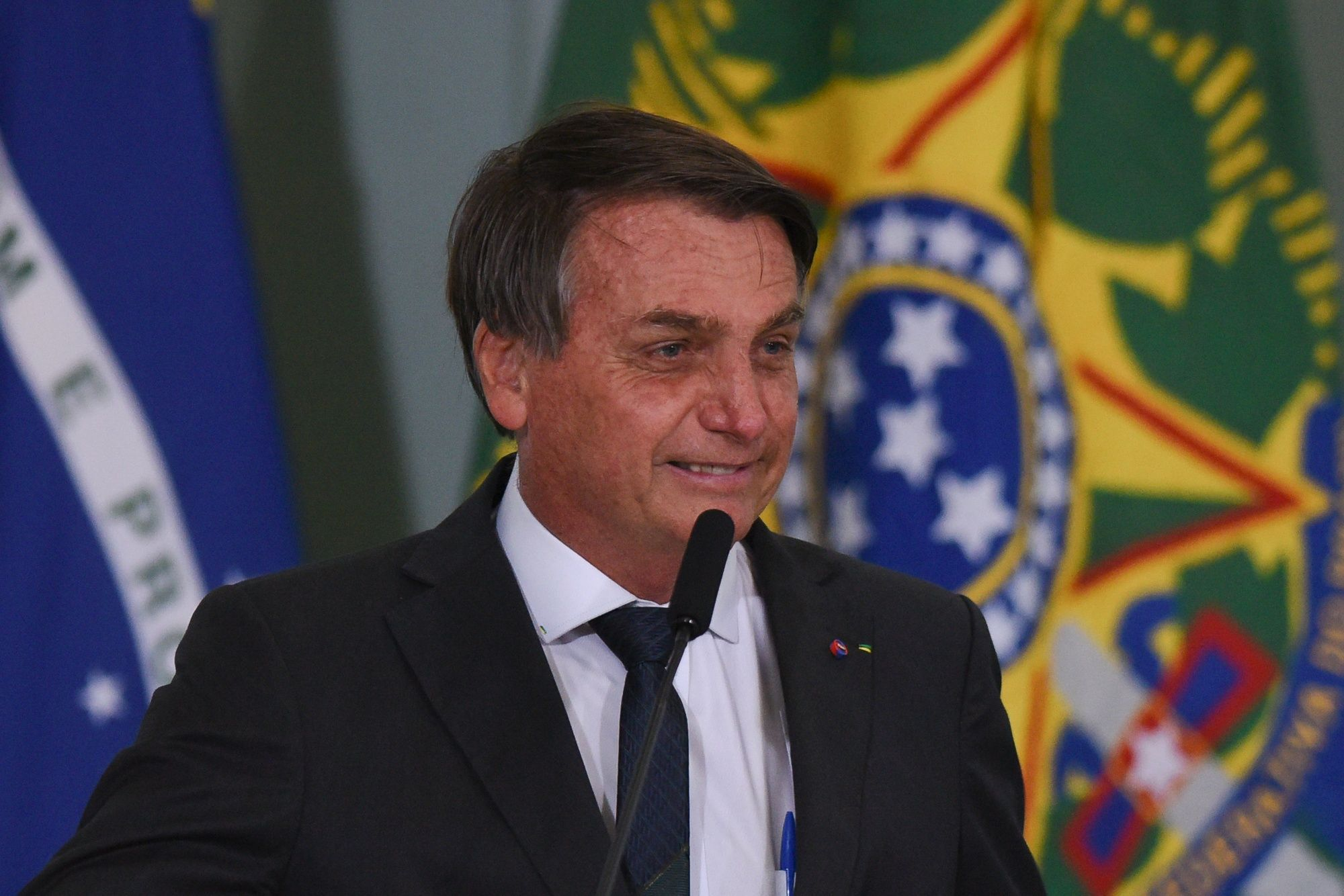 Jair Bolsonaro, Brazil's president, speaks during a ceremony at Planalto Palace in Brasilia, Brazil, on Tuesday, Aug. 25, 2020. Disagreement between Bolsonaro and Economy Minister Paulo Guedes over the size and the shape of a new social program led the government to postpone the announcement of its post-pandemic economic plan, leaving the government to announce only a new housing initiative instead.
