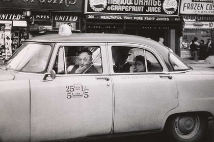 """Taxicab driver at the wheel with two passengers"", N.Y.C. 1956."