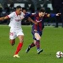 Soccer Football - Copa del Rey - Semi Final Second Leg - FC Barcelona v Sevilla - Camp Nou, Barcelona, Spain - March 3, 2021 Barcelona's Lionel Messi in action with Sevilla's Fernando REUTERS/Albert Gea