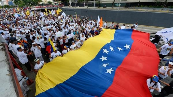 Marcha opositora en Venezuela (AFP)