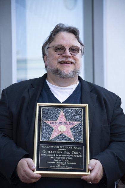 El director se llevó un reconocimiento en alusión a su estrella(Foto: VALERIE MACON / AFP)