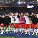 Turkey's players salute at the end of the Euro 2020 Group H qualification football match between France and Turkey at the Stade de France in Saint-Denis, outside Paris on October 14, 2019. (Photo by Alain JOCARD / AFP)
