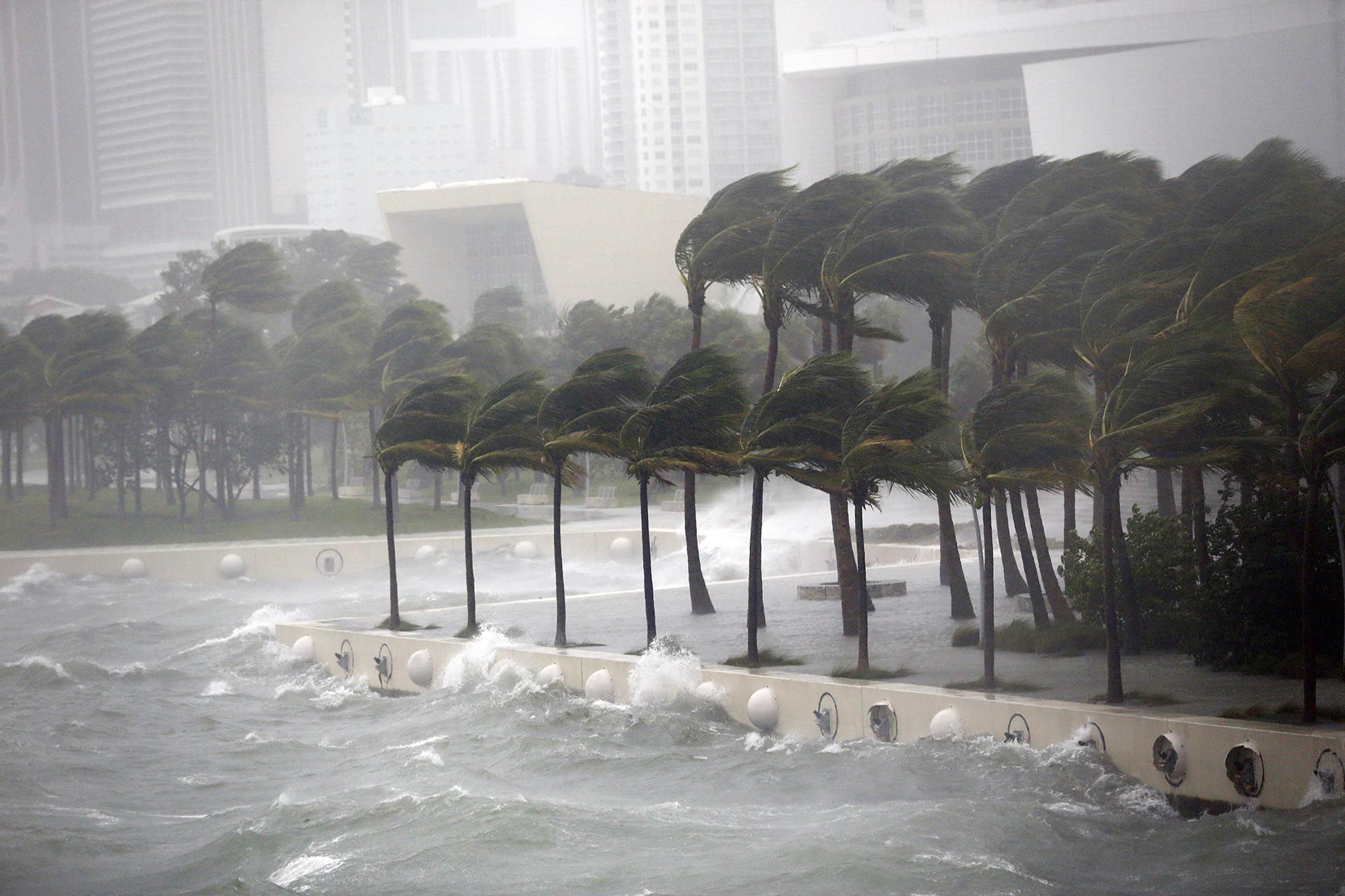 Waves crash over a seawall from Biscayne Bay as Hurricane Irma passes by, Sunday, Sept. 10, 2017, in Miami. (AP Photo/Wilfredo Lee)