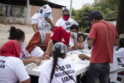 """""""Han desaparecido muchos. Muchas muchachas también jovencitas"""", dijo Blanco Nava. (Foto: AP/Armando Solis)"""