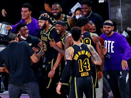 Sep 20, 2020; Lake Buena Vista, Florida, USA; Los Angeles Lakers forward Anthony Davis (3) celebrates with teammates after making the game winning basket against the Denver Nuggets in game two of the Western Conference Finals of the 2020 NBA Playoffs at AdventHealth Arena. Mandatory Credit: Kim Klement-USA TODAY Sports