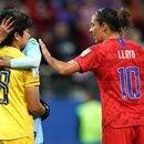 United States' forward Carli Lloyd (R) and Thailand's goalkeeper Sukanya Chor Charoenying (L) react after the France 2019 Women's World Cup Group F football match between USA and Thailand, on June 11, 2019, at the Auguste-Delaune Stadium in Reims, eastern France. (Photo by Lionel BONAVENTURE / AFP)