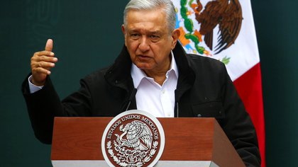 Mexico's President Andres Manuel Lopez Obrador gestures as he speaks during the delivery of an investigation report with relatives of the 43 missing students of the Ayotzinapa Teacher Training College, marking the 6th anniversary of their disappearance, at the National Palace in Mexico City, Mexico September 26, 2020. REUTERS/Edgard Garrido