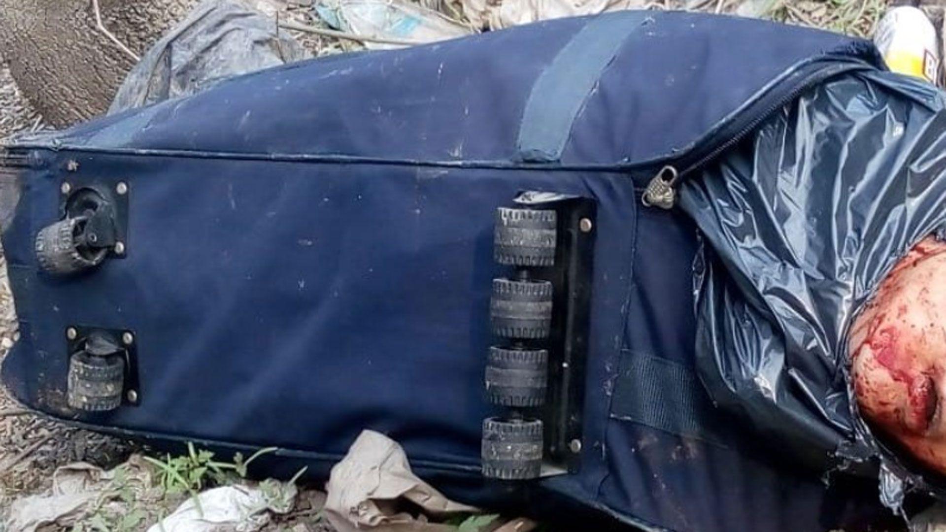 El cuerpo de un hombre con rasgos orientales dentro de una valija fue hallado por dos indigentes en Tristán Suarez