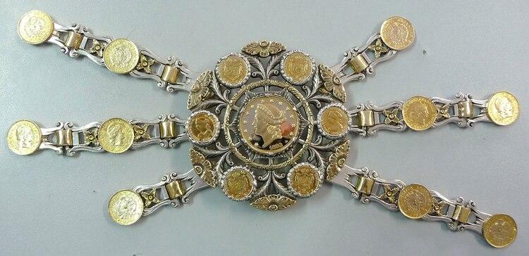 Rastra de plata y oro peso 800 gramos. rescatada del accidente de Medellín.