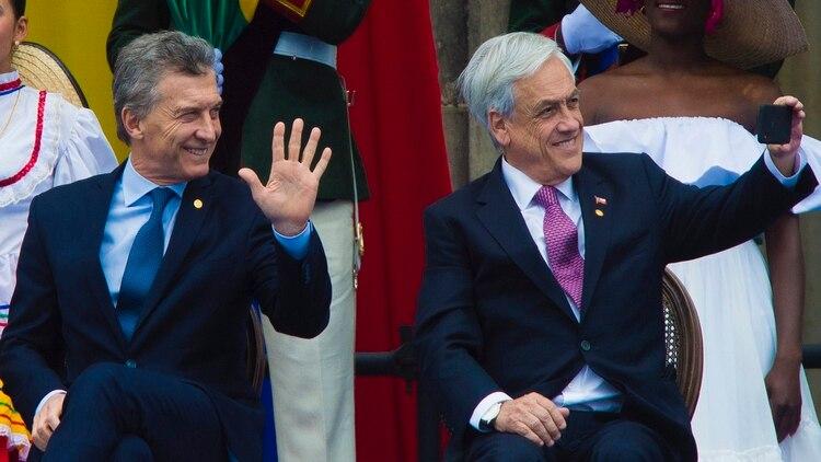 El presidente Macri junto a su par chileno, Sebastián Piñera, en la ceremonia de asunción del nuevo mandatario de Colombia, Iván Duque, en agosto pasado.(Foto: NA)