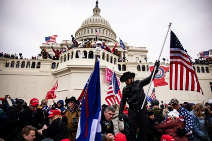 """A mob storms the U.S. Capitol following President Donald Trump's """"Save America"""" rally in Washington, D.C., on Jan. 6."""