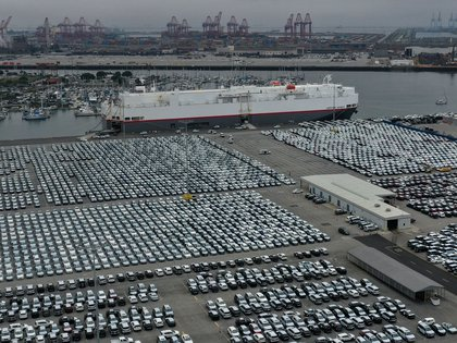 FILE PHOTO: New cars are seen lined up next to the dock as the global outbreak of the coronavirus disease (COVID-19) continues, at the Port of Los Angeles, California, U.S., April 29, 2020.  REUTERS/Lucy Nicholson/File Photo