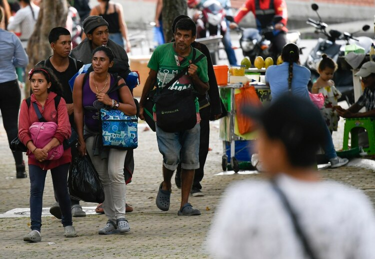 Venezolanos emigran a Colombia (Juan BARRETO / AFP)