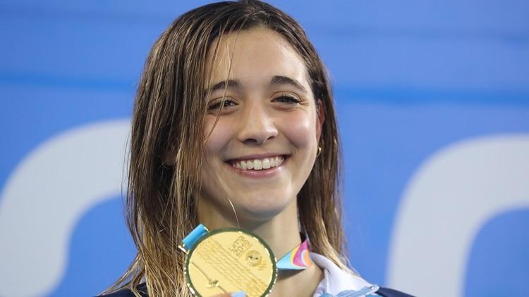 Delfina consiguió tres medallas doradas e hizo historia (Foto: Reuters)